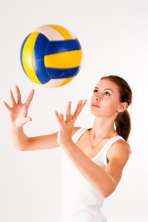 emulate: young, beauty volleyball player at white background