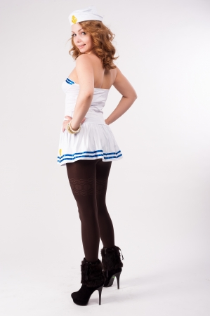 stocking cap: Young beautiful woman in sailor costume at white background