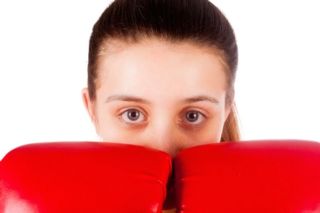 Young beautiful boxer woman with red boxing gloves, close up, isolated on white photo