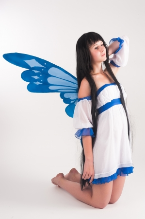 beautiful anime: Beautiful anime girl with long hair and wings  Stock Photo