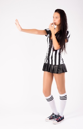 Beautiful Soccer Referee with stop gesture at white background photo