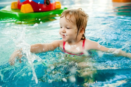 The little girl in the water park Stock Photo