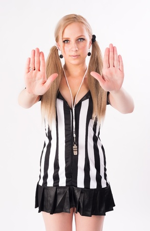 Young attractive referee showing stop gesture at white background Stock Photo