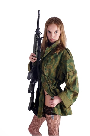Beautiful sexy blond woman holding army rifle photo
