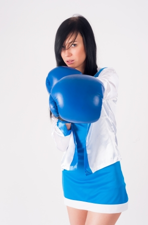 Young woman with boxing gloves isolated on white photo