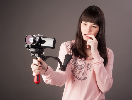 Portrait of the girl reporter with a videocamera photo