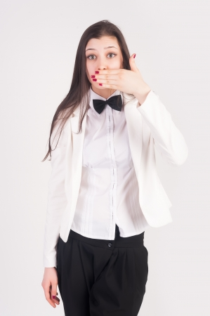 Young businesswoman covering her mouth with her hand photo