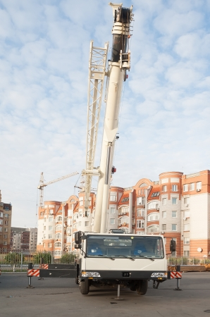 Mobile crane truck and blue sky at construction background photo