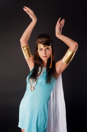 Cleopatra  Woman in egyptian historical dress  Over black  photo