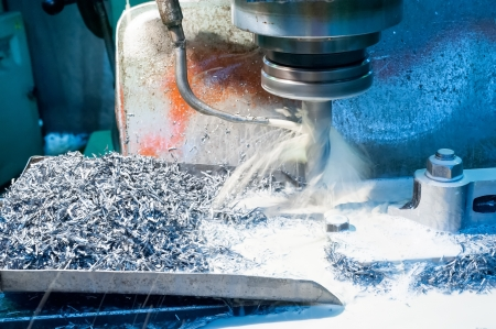 A CNC milling machine milling heads in metal industry photo