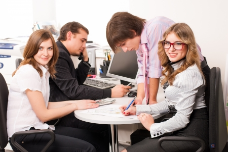 Business people working on project in office photo