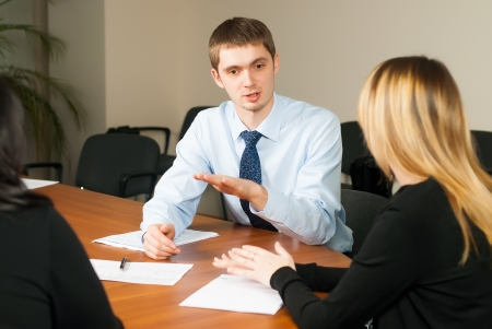 small group of young businessmen in office meeting photo
