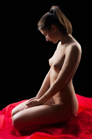 naked young woman: Young beautiful naked woman sitting on a floor