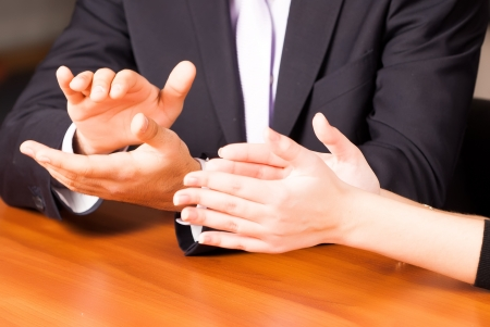 Close up clapping hands of businesspeople at presentation, meeting, seminar or conference photo