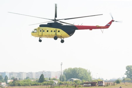 Passenger helicopter MI-8 takes off from heliport photo