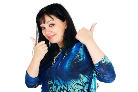 Young pretty woman showing thumb up gesture photo