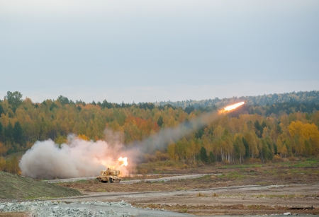 Multiple rocket laucher system from fighting and resupply vehicles attacks target   photo
