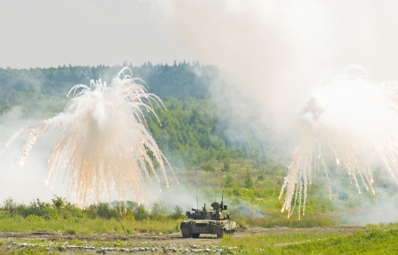 Russian tank  making smoke screen from enemy photo