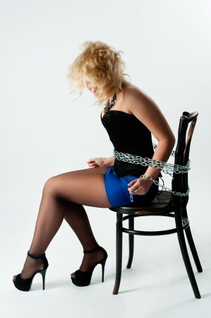 slave girl: Attractive young woman tied up with chains  Isolated on white