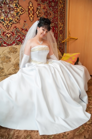 Portrait Of Young Happy Bride at her home photo