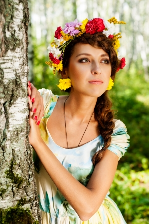 Pretty Woman Portrait with Wreath of Flowers  Natural Beauty photo