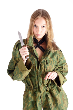 Beautiful sexy blond woman holding hunter knife photo