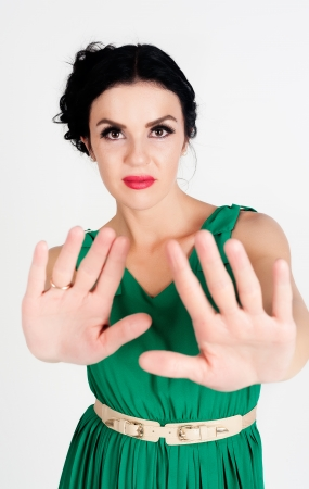 motioning: Young woman motioning to stop over white background Stock Photo