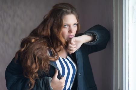 Attractive woman dressed in old telogreika jacket Stock Photo - 23961325