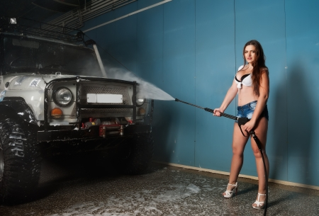 Pretty young woman washing extreme terrain car Stock Photo - 24374058
