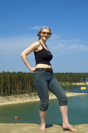 lake beach: Beautiful woman standing at lake beach background