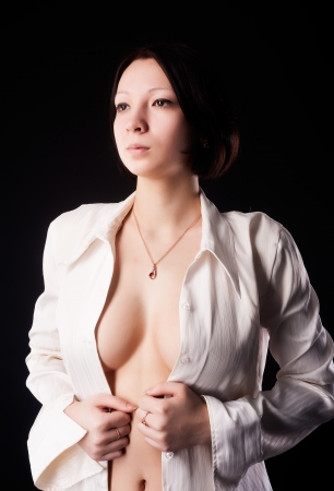 Portrait of sexy young woman in white shirt photo