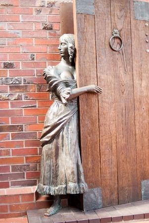 fisherwoman: Sculpture of the fisherwoman waiting returns of the husband from the sea  Fish village, Kaliningrad  Russia Editorial