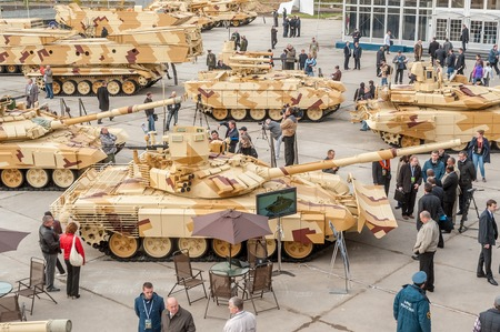 Nizhniy Tagil, Russia - September 25  2013  Visitors examine military equipment on exhibition range  RAE-2013 exhibition