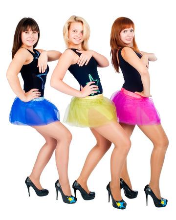Three young beautiful women in dancing costumes photo
