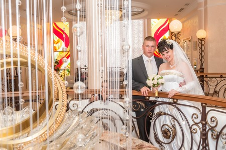 Bride and groom with flower in ceremony palace photo