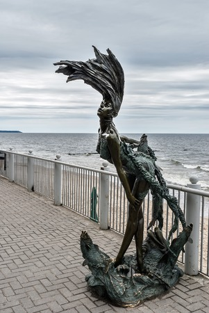 Bronze sculpture of a mermaid Undine, Located on the Promenade in front of the hotel Grand Palace  At Kaliningrad region on June 25, 2010 in Svetlogorsk, Russia