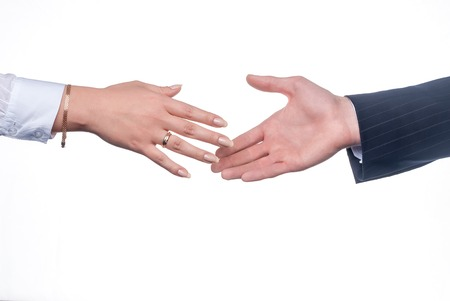 Business man and woman handshake over white background photo