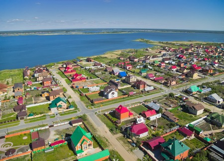 bird s eye: Bird s eye view onto rural street in Borovskiy village  Tyumen region  Russia
