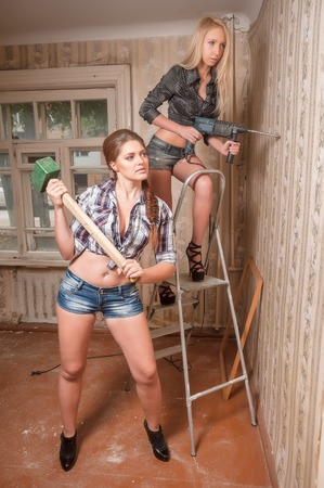 Two beautiful sexy women work in old room photo