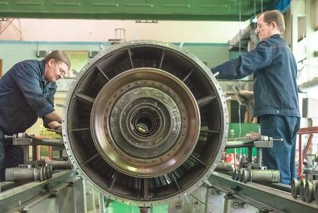 Tyumen, Russia - November 14, 2007  JSC Tyumenskie Motorostroiteli  Plant on production and repair of aviation engines   Mechanics assembly aviation engine Editorial