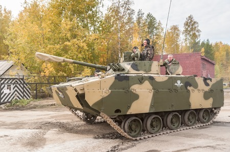 tracked: Nizhniy Tagil, Russia - September 25  2013  Airborne tracked armoured personnel carrier BMD-4M with additional protection on demonstration range  Russia Arms Expo-2013 exhibition