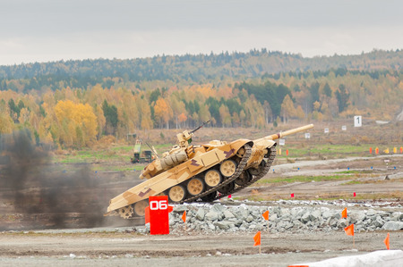 Nizhniy Tagil, Russia - September 25  2013  Russia Arms Expo  RAE -2013 exhibition  Russian military tank T-90S with obstacle overcoming