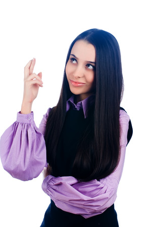 Young beautiful woman showing crossed fingers gesture. Isolated over white photo