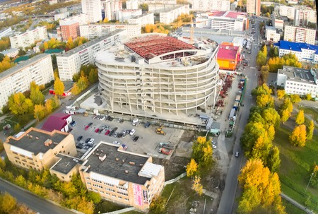 housing lot: Tyumen, Russia - September 27, 2014: Aerial view onto construction of covered parking on Logunova street in fourth residential district Editorial