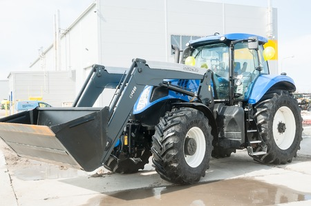 specialized job: Tyumen, Russia - April 04. 2014: IV Tyumen specialized exhibition Agricultural Machinery and Equipment. Plow tractor on special dirt range