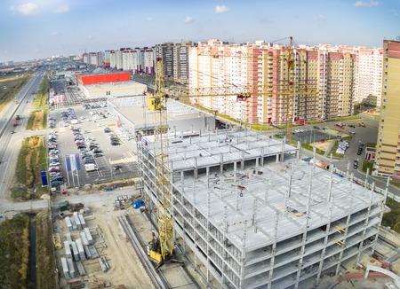 housing lot: Tyumen, Russia - September 30, 2014: Aerial view onto construction of shopping center on Fedyuninskogo street Editorial