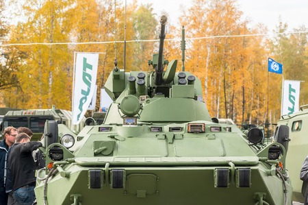 road warrior: Nizhniy Tagil, Russia - September 25. 2013: Visitors explore military equipment on exhibition range. BTR-82A armoured personnel carrier. RAE-2013 exhibition Editorial