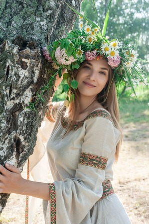 Attractive Woman Portrait with Wreath of Flowers (Ivan Kupala Holiday Celebration) photo