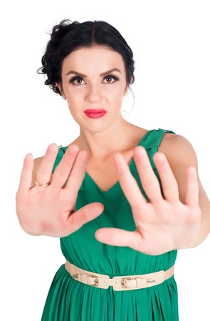motioning: Young attractive woman motioning to stop over white background