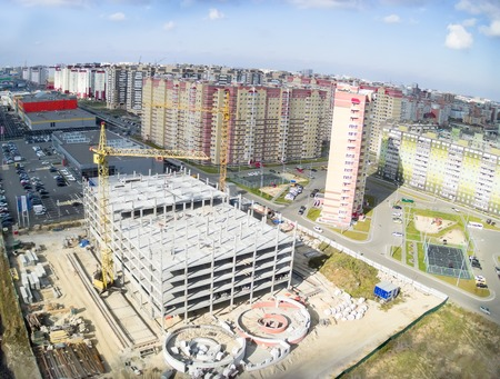 Tyumen, Russia - September 30, 2014: Aerial view onto construction of shopping center on Fedyuninskogo street